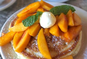 Thick, fluffy pancakes with fresh peaches from the Alexis Baking Company in Napa.