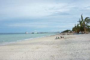 View of the pier and the barge from the sandy shores of Bantayan.